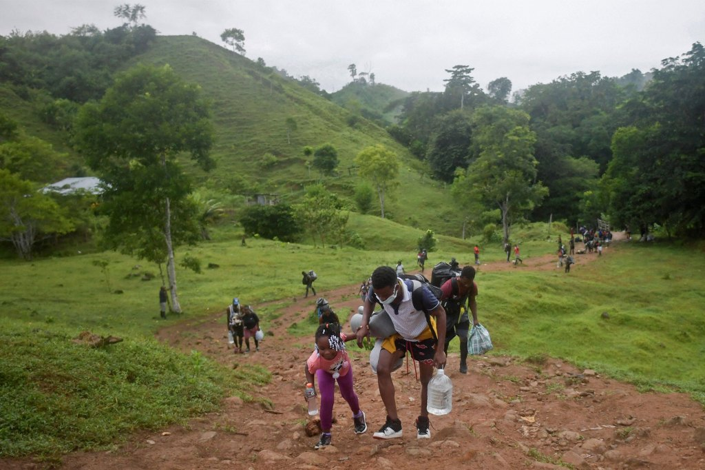 Haitian migrants cross the jungle of the Darien Gap, near Acandi, Choco department, Colombia, heading to Panama.