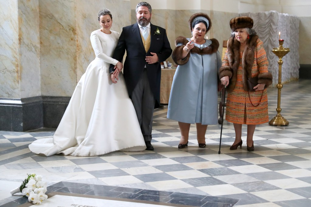 Grand Duke George Mikhailovich of Russia (2nd from left) and Rebecca (Victoria) Bettarini of Italy (left), Grand Duchess Maria Vladimirovna of Russia (second from right) and an unidentified guest visit the tombs of members of the Romanov dynasty.