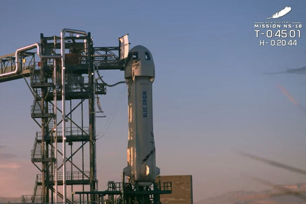 In this still image taken from a Blue Origin video, the New Shepard rocket sits on the launch pad prior to lift off on October 13, 2021,