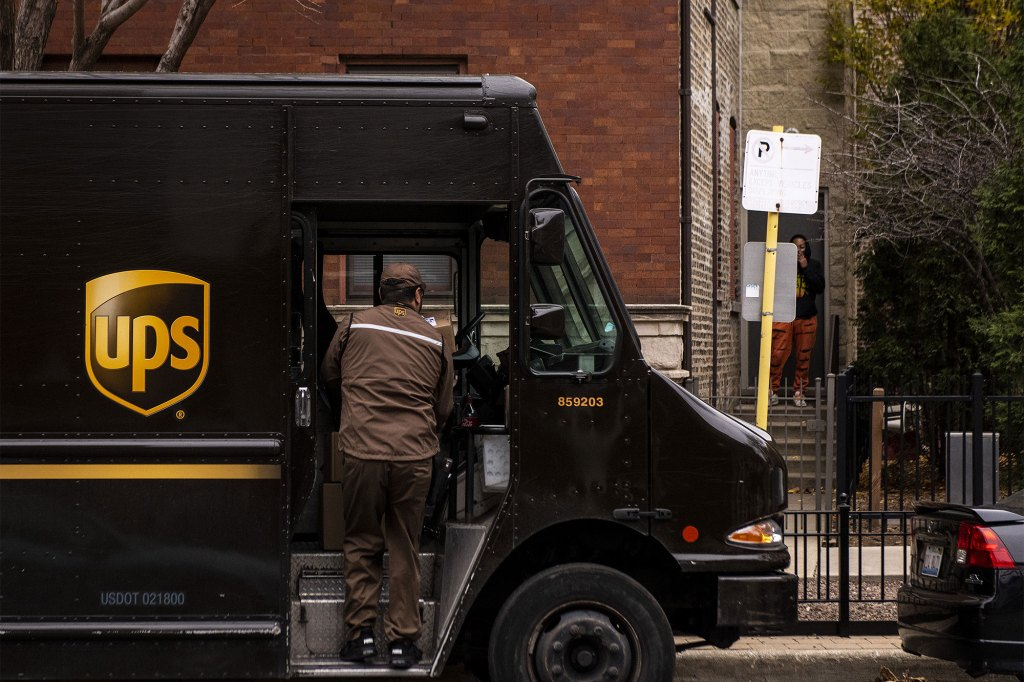 A United Parcel Service Inc. (UPS) driver unloads package in the Lincoln Park neighborhood of Chicago, Illinois, U.S., on Monday, Nov. 30, 2020.