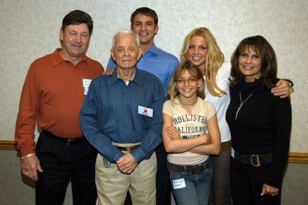 Jame Spears (in red) with son Bryan, father June, daughters Jamie Lynn and Britney, and ex-wife Lynne.