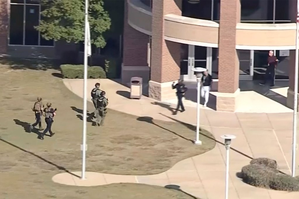 Armed law enforcement arrive at the entrance of Timberview High School in Arlington, Texas amid a shooting.
