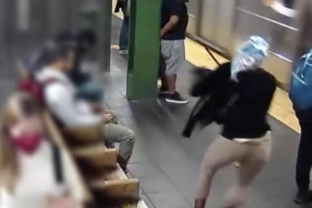 A woman shoves another person into the side of an oncoming train in Times Square.