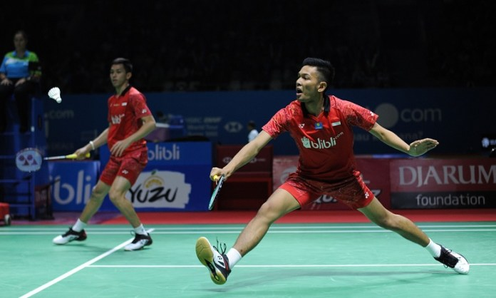 Fajar Alfian/Muhammad Rian Ardianto menyudahi perlawanan Takeshi Kamura/Keigo Sonoda, dalam laga rubber game, babak pertama Blibli Indonesia Open 2018 HSBC BWF World Tour Super 1000. (Pras/NYSN)