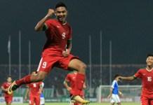 Striker Timnas U-19, Muhammad Rafli Mursalim melakukan selebrasi di laga Piala AFF U-18, saat menghadapi Singapura U-19, pada Selasa (3/7).(bolasport.com)