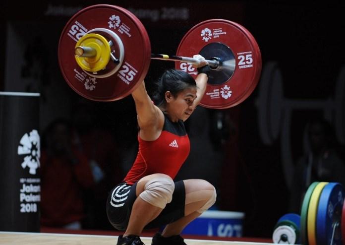 Gagal melakukan angkata Clean and Jerk dengan baik, Lifter putri Indonesia, Sri Wahyuni Agustiani, urung menyumbang medali emas Asian Games 2018 cabor angkat besi, di kelas 48 kilogram putri. (Pras/NYSN)