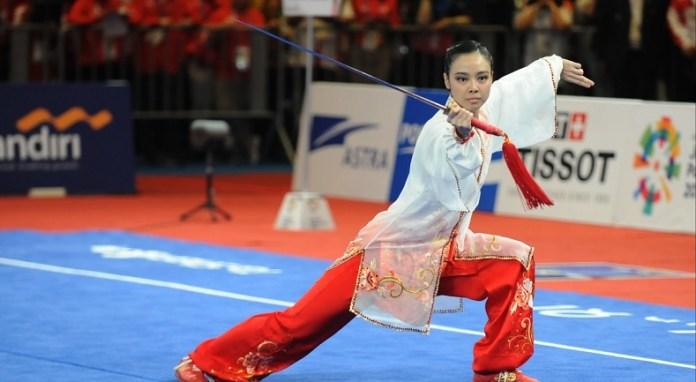 Usai meraih emas di nomor Taijiquan-Taijijian putri Asian Games 2018, atlet wushu Indonesia, Lindswell Kwok, berencana pensiun dari olahraga yang membawanya menjadi peraih empat medali emas Sea GAMES berturut-turut, sejak 2011-2017. (Pras/NYSN)