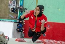 Aries Susanti Rahayu meluapkan kegembiraannya usai merebut gelar juara dunia dalam kategori women's speed, di ajang IFSC Climbing World Cup, di Wujiang, China, pada 20-21 Oktober 2018. (FPTI)