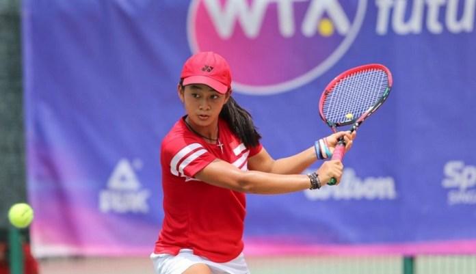 Petenis muda Indonesia, Priska Madelyn Nugroho (15 tahun), akan memulai debutnya di ajang Grand Slam, Australia Open Junior 2019, pada Minggu (20/1). Peringkat ke-45 junior dunia itu, bakal menghadapi wakil Korea Selatan (Korsel), Yeon Woo Ku. (tribunnews.com)