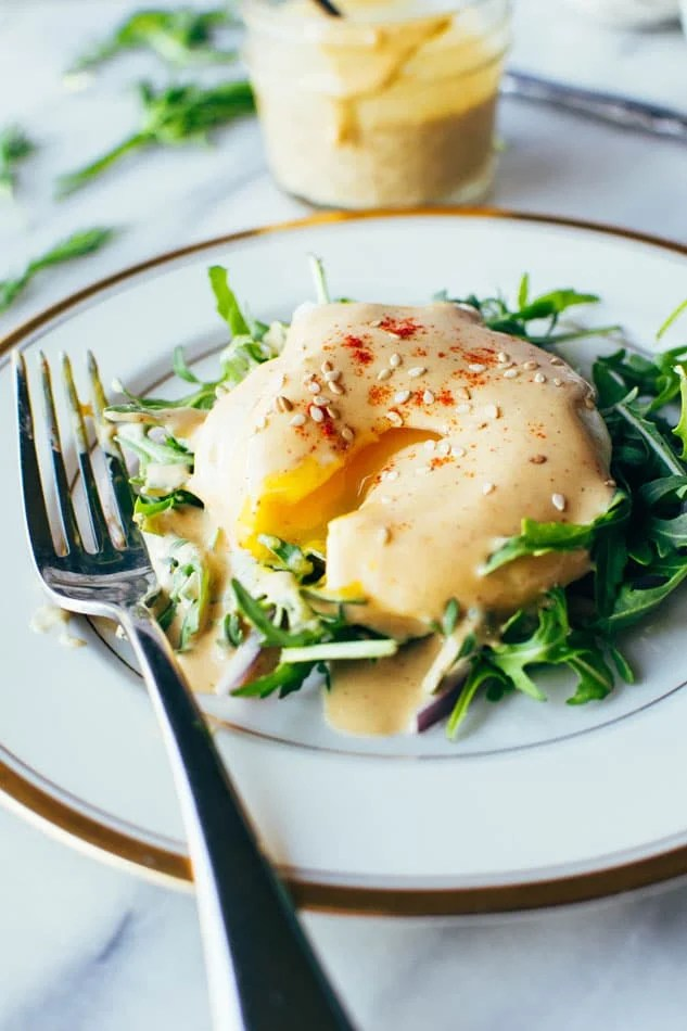 Easy dairy free tahini hollandaise sauce! So simple to make (in a blender!) and still full of healthy fats and delicious flavor for your endless list of things that you have just been waiting to drown in hollandaise goodness.