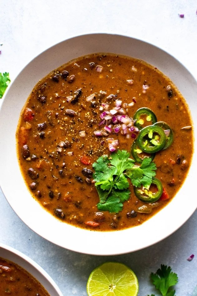 The best vegan black bean soup is made with simple ingredients like canned black beans, veggies and some flavorful spices. Hearty and full of flavor and nutrition! Top it with your favorite garnishes like cilantro, red onion and lots of lime for a satisfying and easy soup!