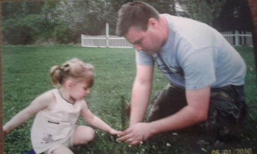 Jeff Bell planting a tree with his daughter