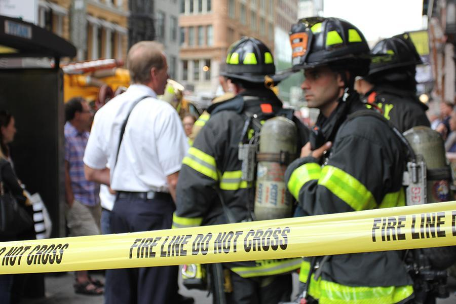 Firefighters+stand+behind+caution+tape+outside+of+Strand+Bookstore.