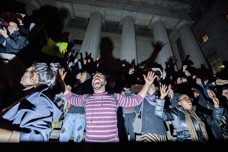 Protesters gather on Wall Street the second night following the decision not to indict officer Darren Wilson for the shooting of Michael Brown.