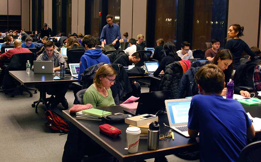 Students study on the fifth floor of Bobst as finals approach.
