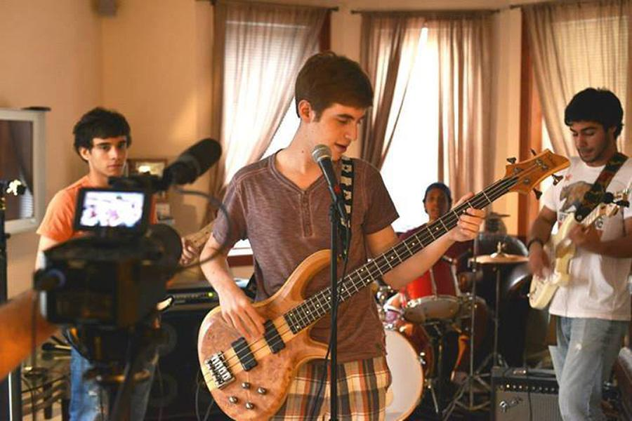 Mike Prussack, center, is an LS freshman in the folk-rock band, Fiscal Cliff.