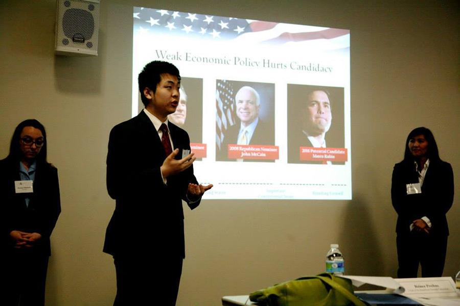 Joe Wang, center, presents on domestic policy. His team's presentation won the final round of NYU's second Public Policy Case Competition on Saturday.