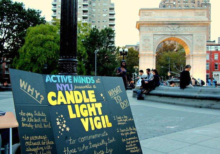 NYU Active Minds set up a poster in Washington Square Park as part of a vigil for those who have committed suicide.