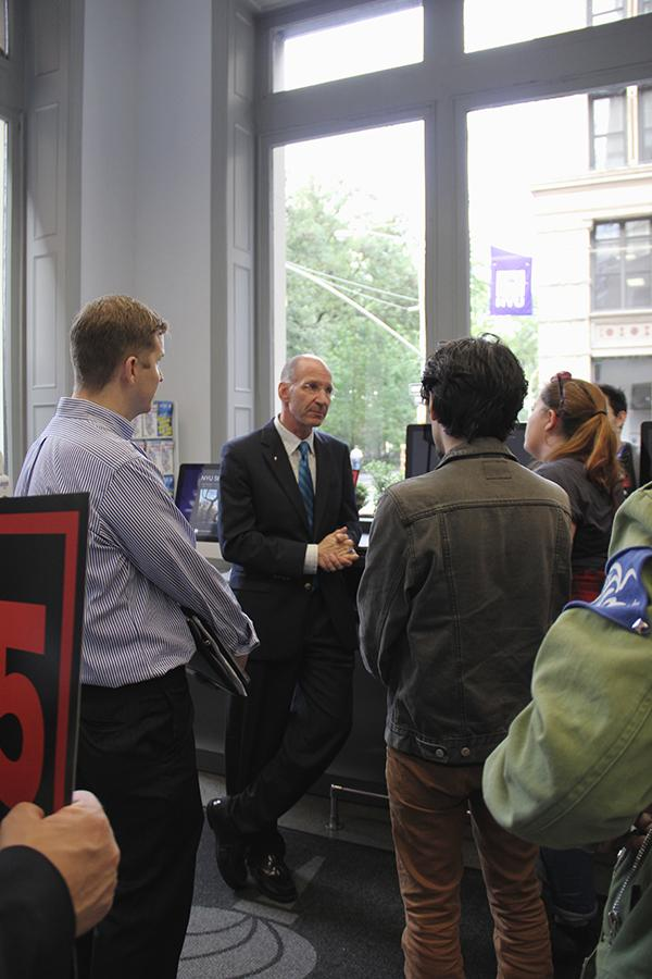 Members of NYU's Student Labor Action Movement (SLAM) discuss a potential meeting about raising student worker pay to $15 an hour with NYU Senior Vice President for Student Affairs Marc Wais in the NYU Welcome Center on Friday, Oct. 9, 2015.