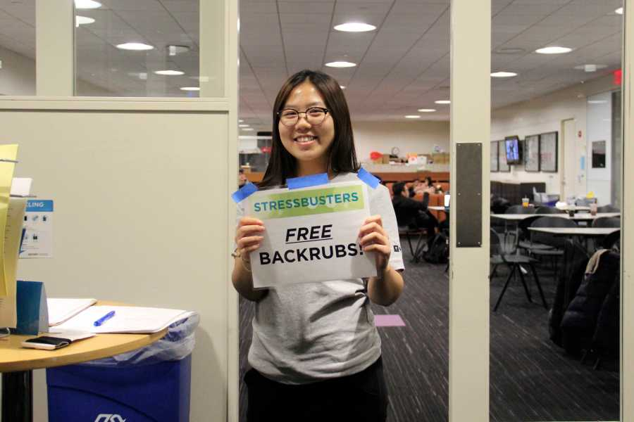 Stressbusters volunteer, Catherine Kim, offers free back rubs at Take a Break Tuesday in the Kimmel Center for University Life on Nov. 24, 2015.