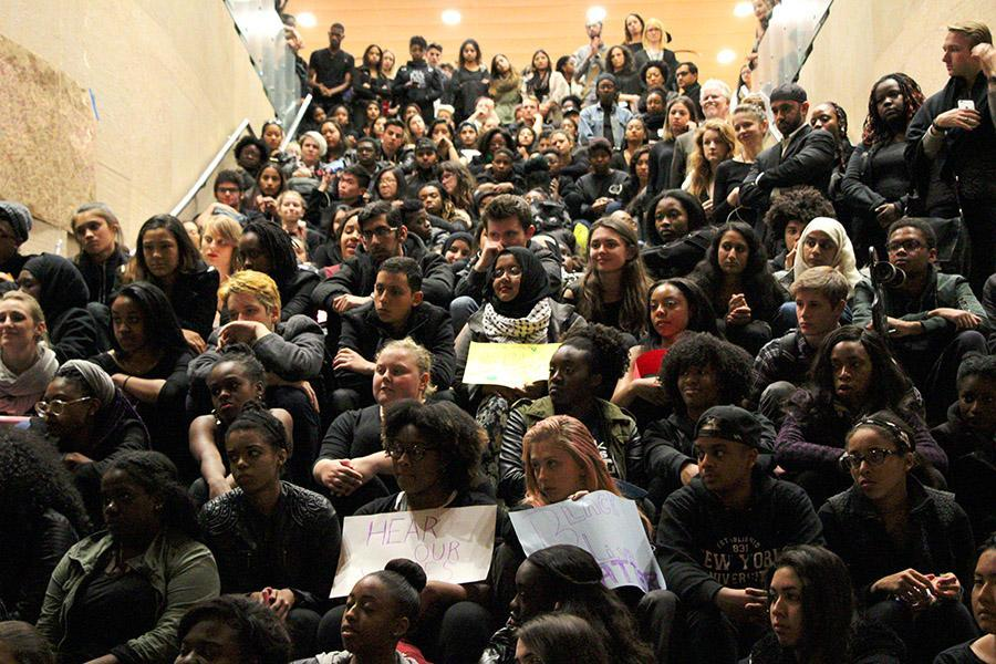 A crowd of students and faculty filled the lobby of Kimmel Center on Monday evening in a show of solidarity for students of color.