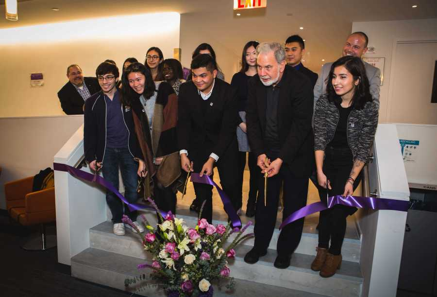 John Sexton along with members of the Commuter Student Council cut the ribbon to Hayden Hall's new commuter den.