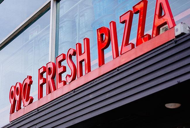 Dollar pizza is a common food option for NYU students on a budget.