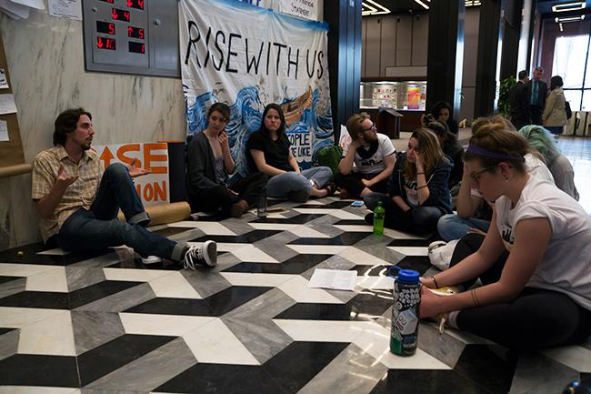 NYU Divest members occupied part of the first floor of Bobst Library, blocking the elevator that leads to executive offices on Monday, April 18, demanding to meet with the Board of Trustees who would vote on divestment at their next meeting.