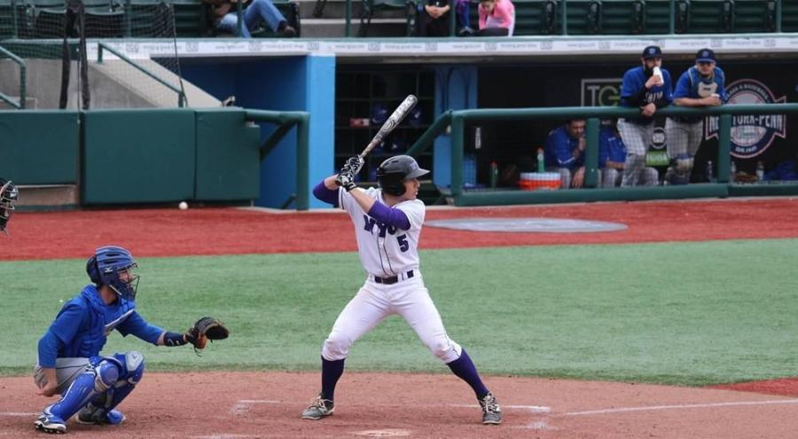 A pair of home runs from Adrian Spitz led the offensive barrage for the Violets in a blowout win over John Jay College on Tuesday.