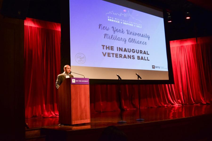 Assistant Director of the NYU Student Resource Center, Rollie Carencia, introduces everyone to the Veteran's Ball.