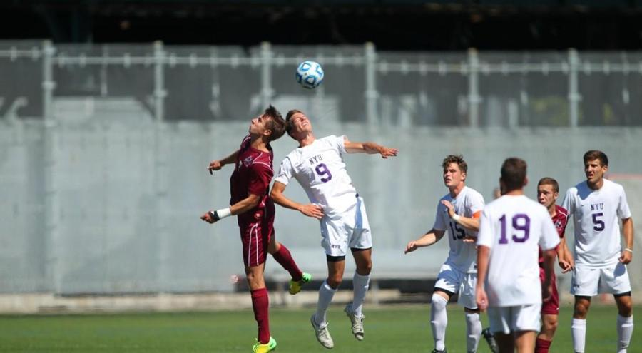Junior Nic Notaro, who plays forward, goes in for a header against Mt. St. Vincent.