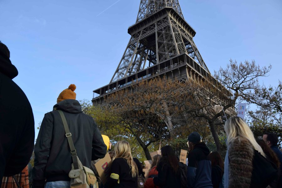 The Eiffel Tower looms over marchers as they head toward Pont d'Iena.