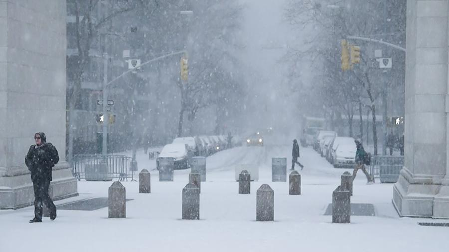 Washington Square Park and 5th Avenue in the snow. New York expects to see heavy snow showers Wednesday night.