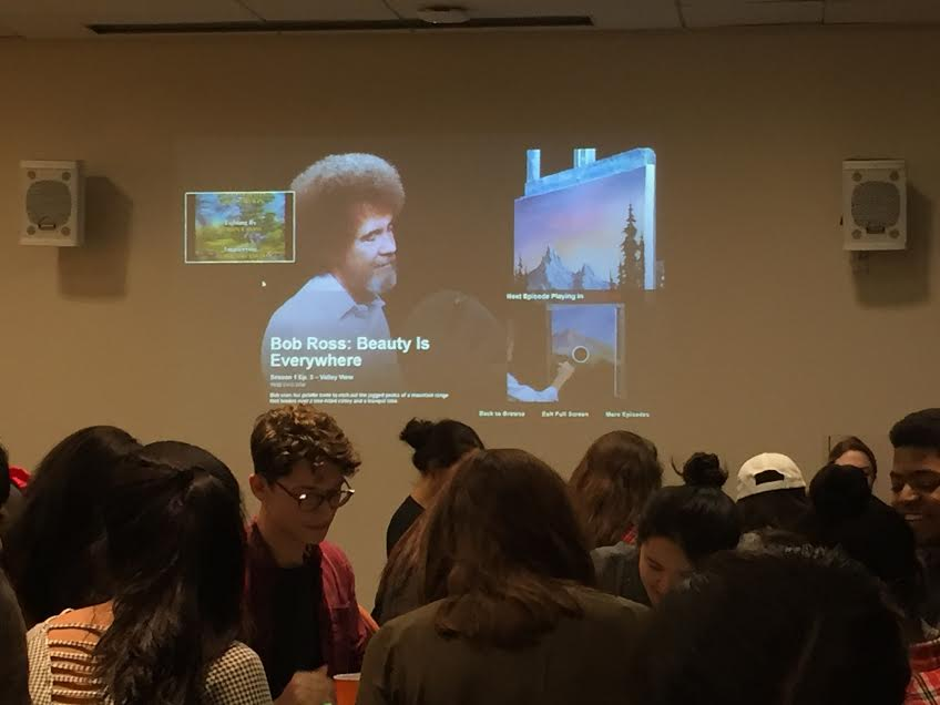 Attendees painted as Bob Ross videos played in the background.