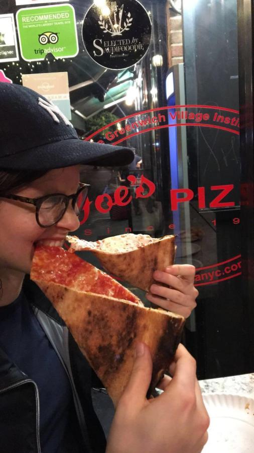 Juliana Fonseca-Alesso takes a bite out of two pizza slices simultaneously during the week in which she tried eating only pizza.