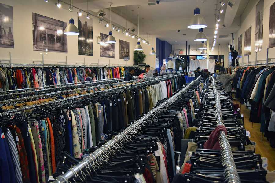 The Goodwill Store, located at 44 W 8th St, also sells gently worn clothing for cheap.