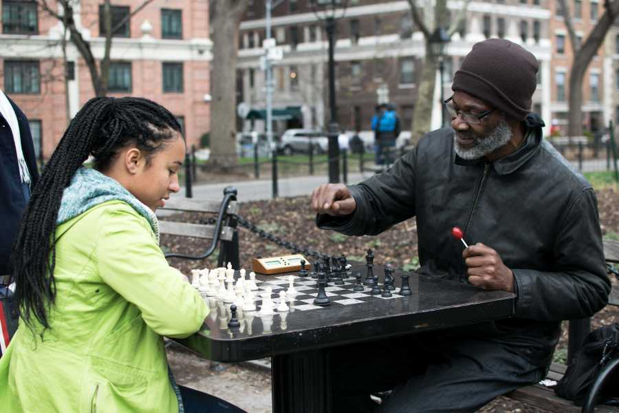 Cornbread, a famous Washington Square Park chess player, has been playing chess for 20 years in the park.