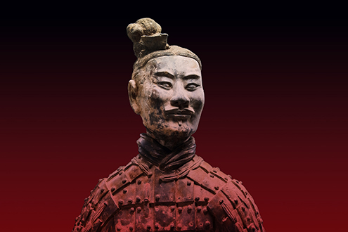 """""""Kneeling Archer,"""" Earthenware of the Qin Dynasty, 201-206 B.C.. Artifacts from the Qin and Han Dynasties of China are on display at the Metropolitan Museum as part of its """"Age of Empires"""" exhibition."""
