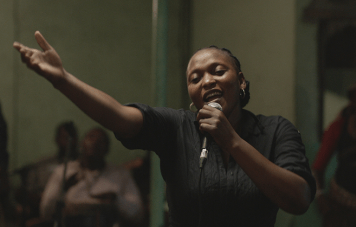 Félicité is a free-willed woman working as a singer in a bar in Kinshasa. Her life is thrown into turmoil when her 14-year-old son gets into a terrible car accident and in order to raise money to save him, she sets out on a breakneck race through the streets of electric Kinshasa – a world of music and dreams.
