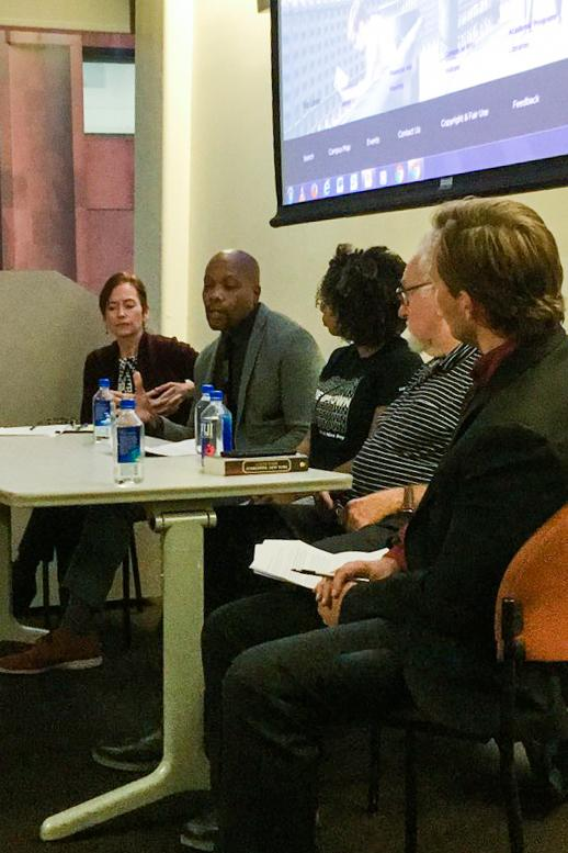 Panelists share their thoughts on gentrification on Bella Quisqueya's Gentrification Panel on the evening of Oct. 16.