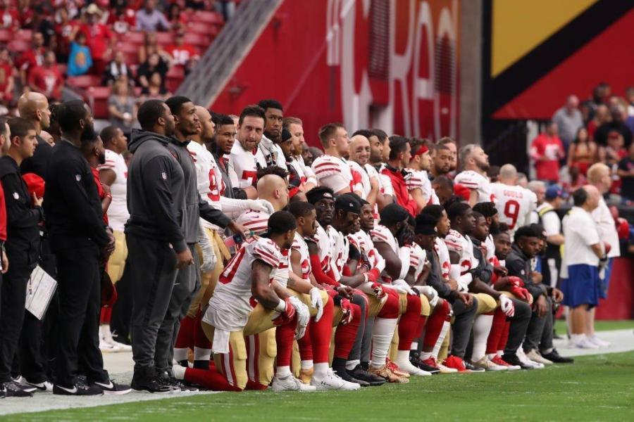 30 players from Kaepernick's former team, the San Francisco 49ers, kneel during the national anthem before their game on Oct 1, 2017.