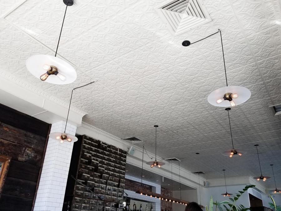 Light fixtures and apothecary-esque drawers in the restaurant.