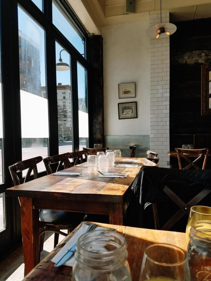 The interior decor of San Marzano, featuring rustic wooden tables and chairs.