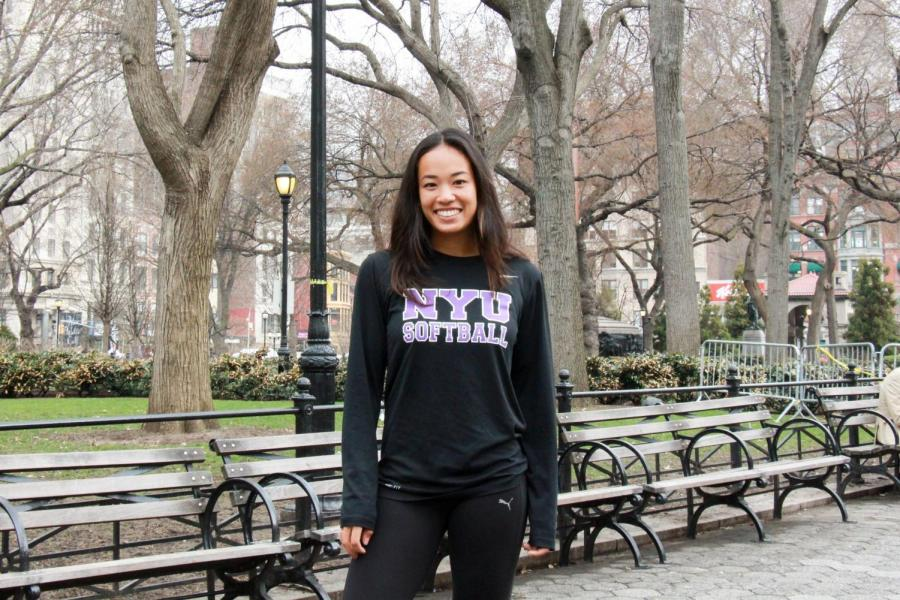 Steinhardt junior Diana King in Washington Square Park. King excels as pitcher and centerfielder for the softball team.
