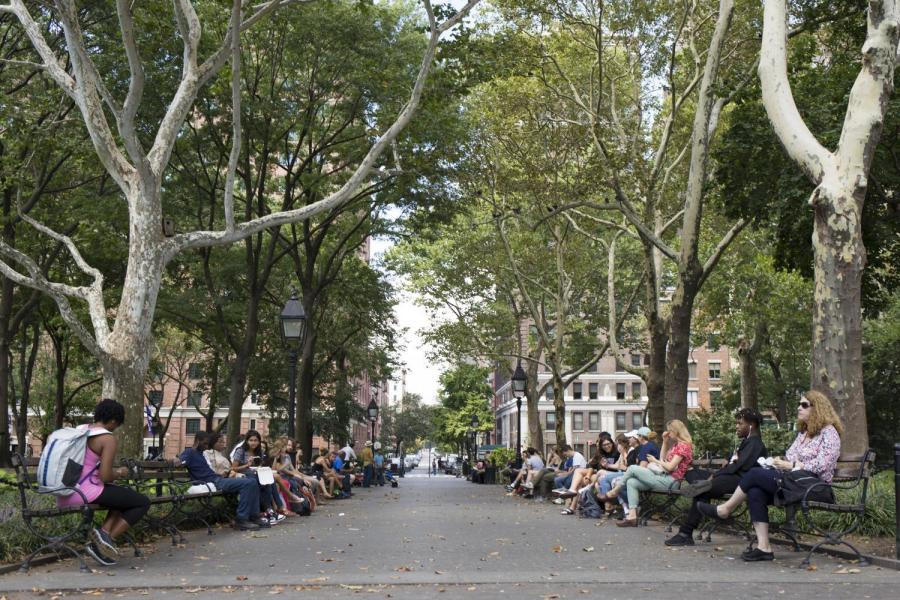 People+enjoying+the+weather+in+Washington+Square+Park.+While+not+stereotypically+productive%2C+it+can+be+beneficial+for+the+body+and+mind+to+go+for+a+walk.+%28Photo+by+Katie+Peurrung%29