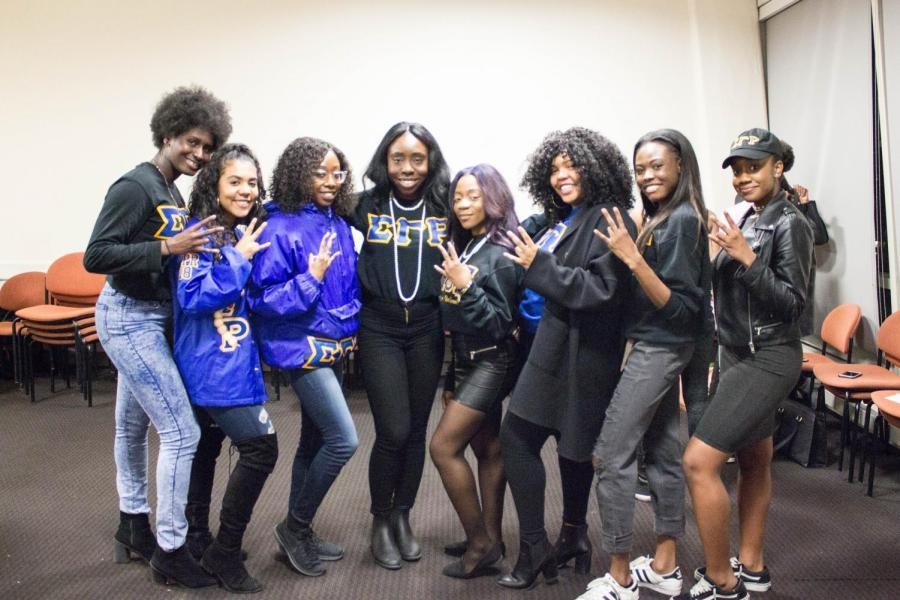 Members of the Tau Epsilon chapter of Sigma Gamma Rho Sorority, Inc. pose with their Sigma hand sign after co-hosting an event in Kimmel on Tuesday.