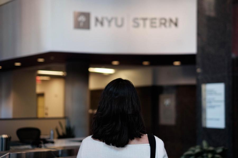 A+Muslim+student+standing+in+the+lobby+of+the+Henry+Kaufman+Management+Center.+Stern+has+recently+gained+attention+from+the+larger+NYU+community+due+to+instances+of+Islamophobia+and+discrimination.+