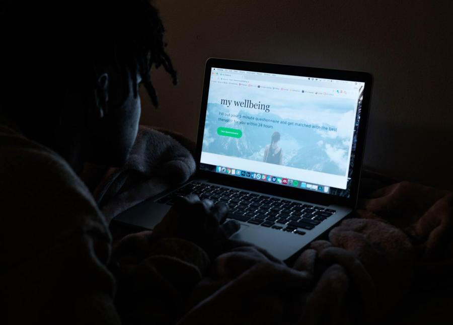 An NYU student looks at the My Wellbeing site, an online service that connects individuals with therapists in the New York City area.