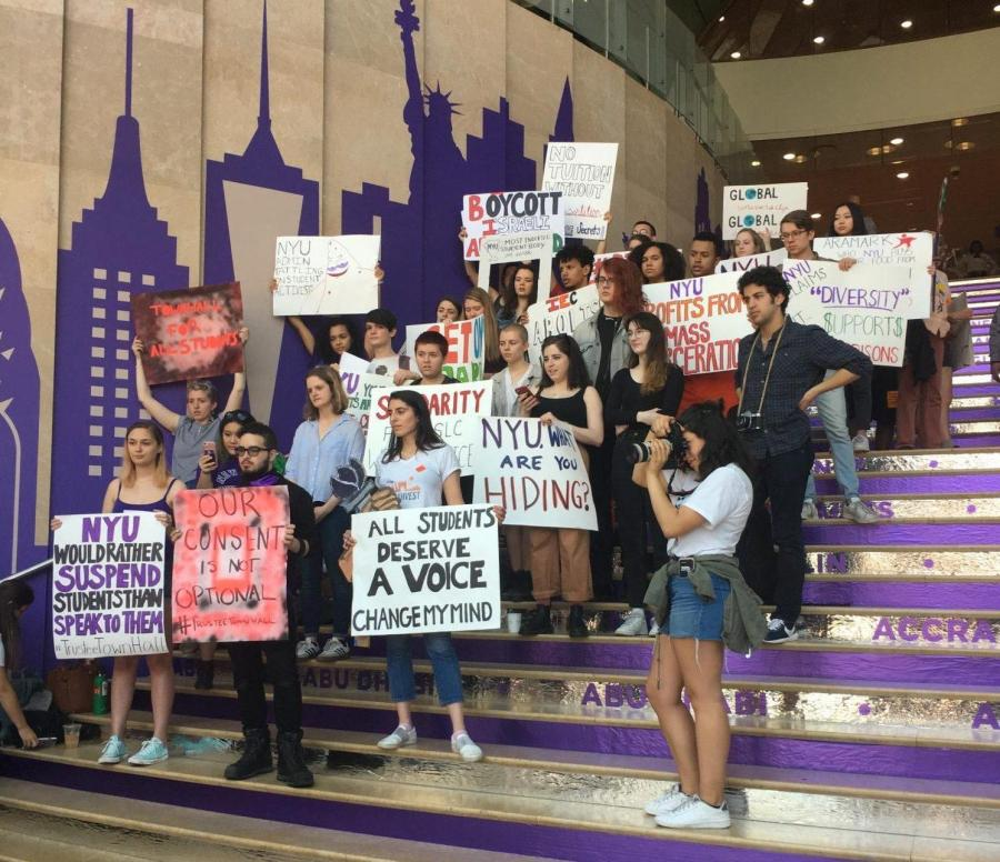 Student+activists+gather+on+the+staircase+of+the+Kimmel+Center+for+University+Life+during+Weekend+on+the+Square+to+protest+for+a+meeting+with+the+Board+of+Trustees