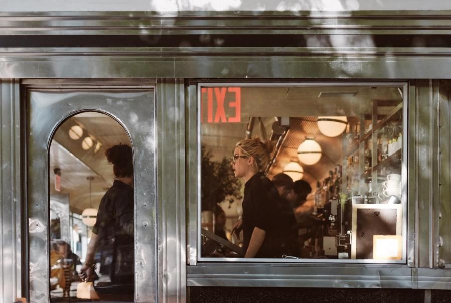 A+server+working+at+a+diner+in+Chelsea.